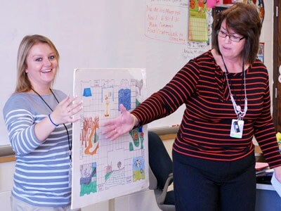 NIU students co-teach at DeKalb High School.