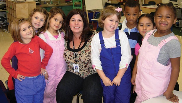 Principal Gina Greenwald visits with students at the former Wright Elementary School.