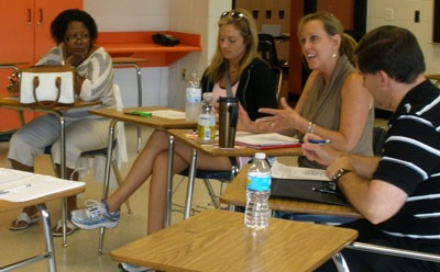 Twelve NIU faculty members and doctoral students worked with 236 Rockford high school teachers in a two-week intensive seminar this summer to improve students' literacy skills.
