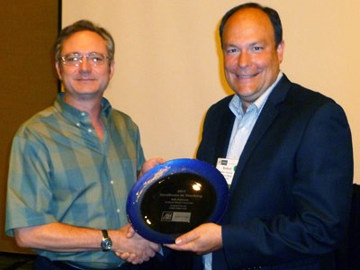 Robert Peterson, right, is congratulated by Mark Johlke, vice president of the Sales Special Interest Group of AMA.