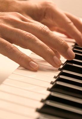 Photo of fingers on piano keys