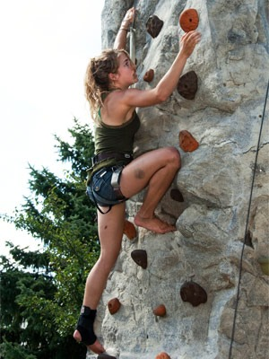 Photo of student scaling a climbing wall