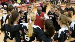 Photo of volleyball team huddle