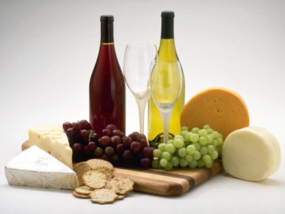 Photo of wine, cheese and fruit