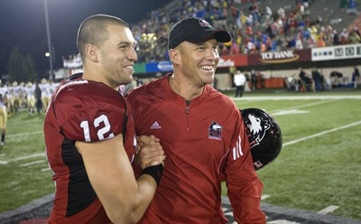 Harnish and Doeren celebrate