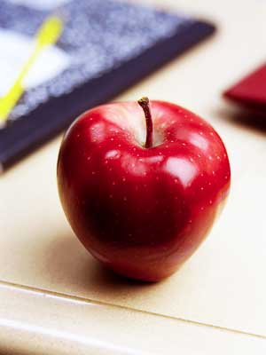 Photo of an apple on a teacher's desk