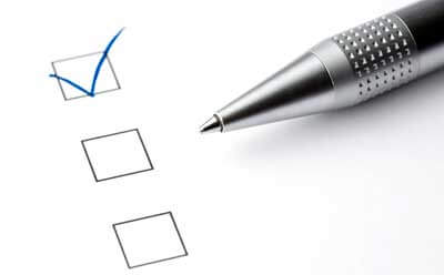 Photo of a pen and a checked box on a ballot
