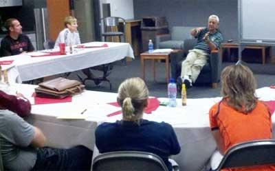 Dick Bennett talks to Huskie coaches