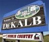 "Photo of a ""Welcome to DeKalb: Huskie Country"" road sign"