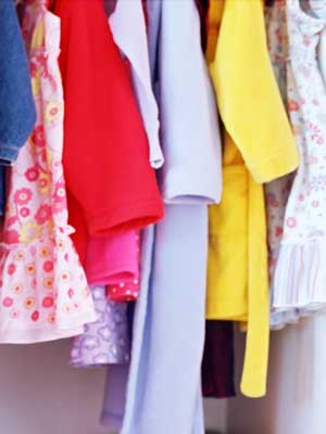 Photo of women's clothing hanging in a closet