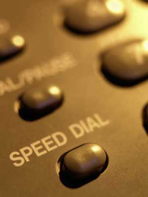 """Photo of the """"Speed Dial"""" button on a telephone"""