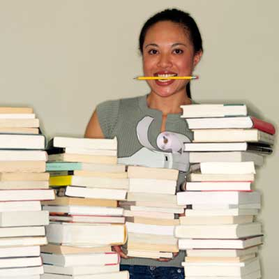 Photo of a woman behind stacks of books