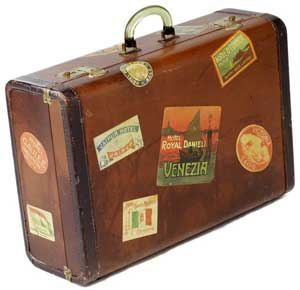 Photo of a suitcase with international travel stickers