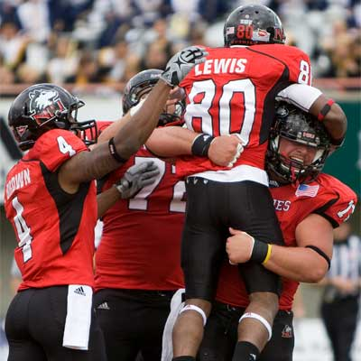 Tommylee Lewis celebrates a touchdown Saturday vs. Cal Poly.