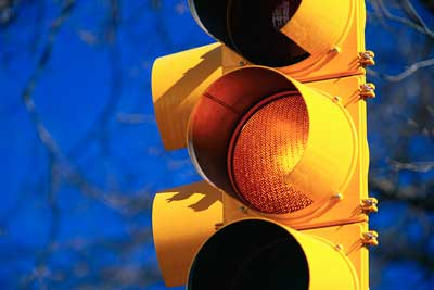 "Photo of a traffic light on ""yellow"""