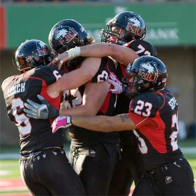 The Huskies celebrate a Jordan Lynch touchdown against Kent State.