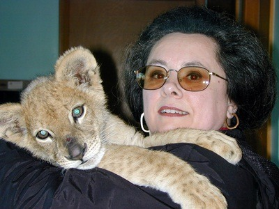Virginia Naples with a modern-day lion cub.