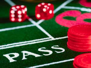 Photo of a casino table with dice and chips