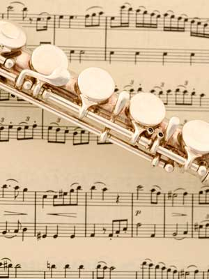 Photo of a flute placed on sheet music