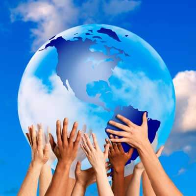 Photo of diverse hands holding globe