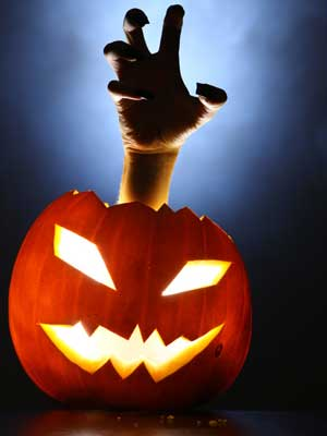 Photo of jack-o-lantern with hand reaching out