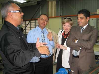 Wan Azhar bin Wan Yusoff, director of the Center for Academic Innovation and Competitiveness at UMP, talks to Promod Vohra, Deborah Pierce and Omar Ghrayeb.