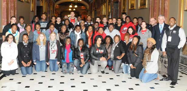 Rep. Robert Pritchard poses with NIU students in the Capitol.