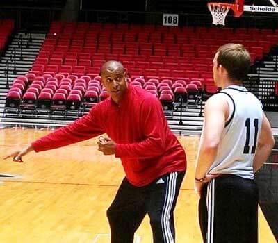 Men's basketball coach Mark Montgomery works with freshman Zach Miller.