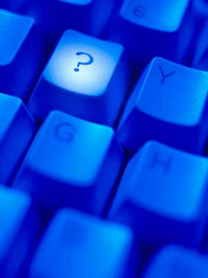 """Photo of a """"?"""" key on a computer keyboard"""
