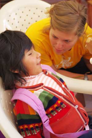 NIU alumna Molly Clesen teaches a song to a 4-year-old Bolivian child who is visually impaired.