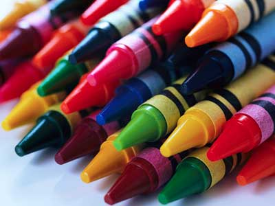 A photo of stacked crayons