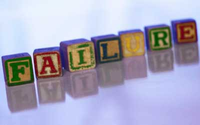"Photo of child's alphabet blocks spelling the world ""FAILURE"""