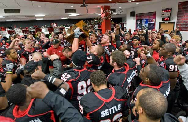 The NIU Huskies celebrate with the Bronze Stalk after the Nov. 15 victory.