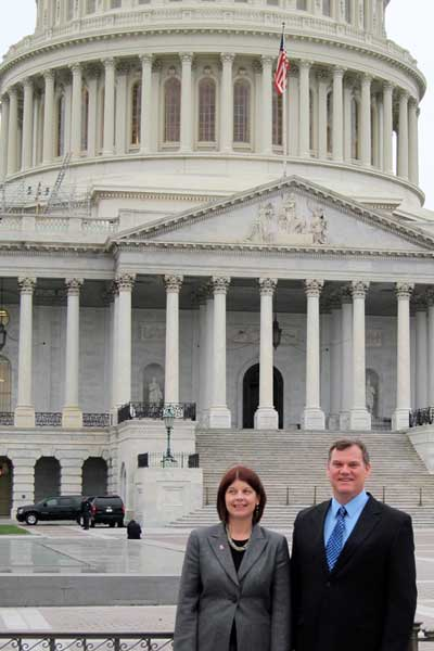 Lisa Freeman and Timothy Hagen stand outside the U.S. Capitol.