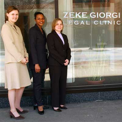 NIU College of Law students stand outside the doors of the Zeke Giorgi Legal Clinic in downtown Rockford.