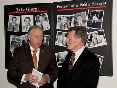 NIU President John Peters and Mike Madigan, speaker of the Illinois House of Representatives, speak Wednesday during the 10th anniversary celebration of NIU's Zeke Giorgi Legal Clinic.
