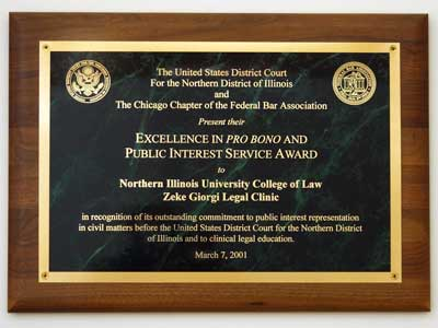 Photo of a plaque awarded to NIU's Zeke Giorgi Legal Clinic for excellence in pro bono and public interest services.
