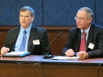 NIU chemistry professor Timothy Hagen (left) speaks Tuesday to Washington, D.C., power brokers about the importance of federal funding for research universities.