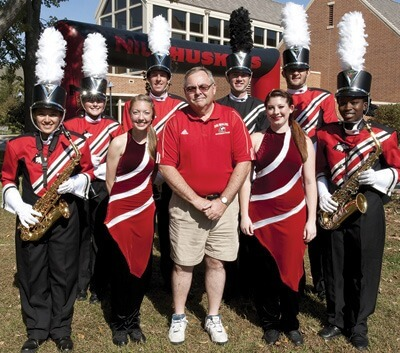 Steve Kalber (center) with members of the marching band at Homecoming.