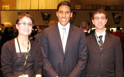 Kaitylnn Carter, left, and Gary Timmins, right, meet SCUSA 63 banquet keynote speaker Rajiv Shah, administrator of the U.S. Agency for International Development.