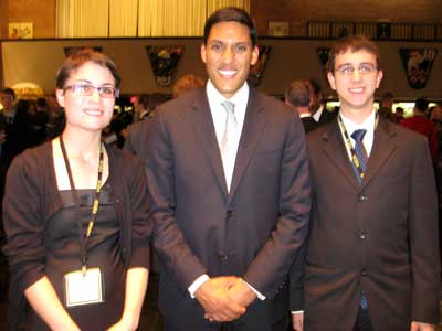 Kaitlynn Carter, left, and Gary Timmins, right, meet SCUSA 63 banquet keynote speaker Rajiv Shah, administrator of the U.S. Agency for International Development.