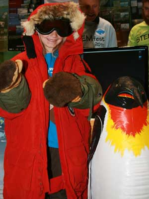 Kids tried on Ross Powell's Arctic gear. Powell, an NIU Board of Trustees Professor of geology, is one of the creators of the DOER submarine, which will explore the West Antarctic Ice Sheet in 2013.