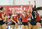 NIU Huskies volleyball team celebrates
