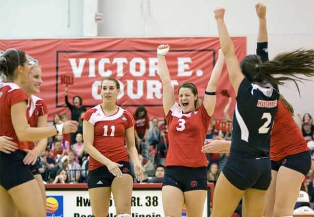 NIU Huskies volleyball team celebrates