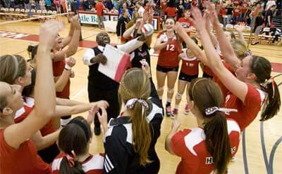 NIU volleyball team celebrates