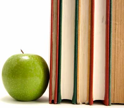 Photo of an apple used as a bookend