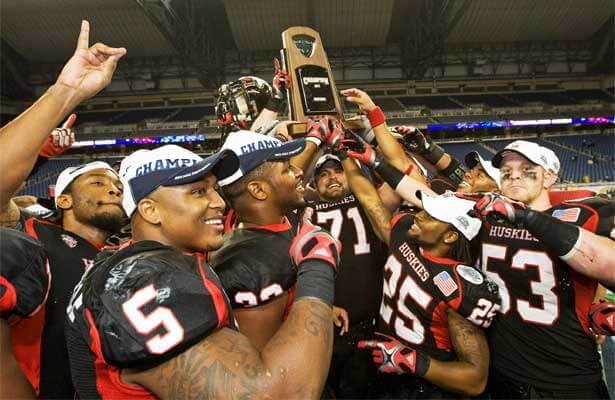 Victorious NIU Huskies hoist the 2011 Marathon MAC Championship trophy