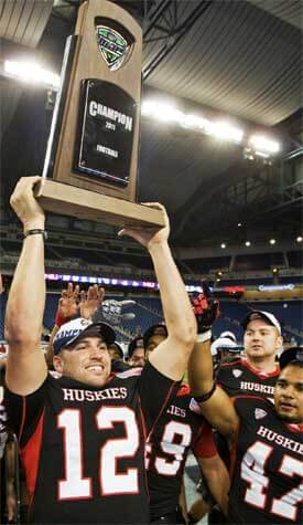 Quarterback Chandler Harnish displays the championship trophy to the happy Huskie Nation.