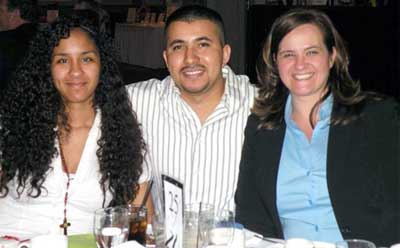 Yolanda (right) enjoys a MELD banquet with her husband, Usvaldo, and her oldest daughter, Alejandra.