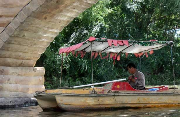 Photo of a man in a rowboat in China